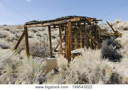 Boarded up old pumice mine shaft Mono County California