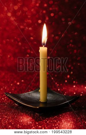 Still Life Golden Candle Light With Reflection On Red Blurred Bokeh Background. ,abstract Background