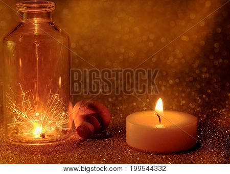 Concept Of Sparklers In Glass Jar At Night And  Golden Light Candle Burning With Golden Light Bokeh