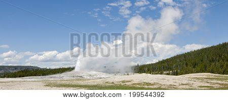 Old Faithful Geyser erupting at Yellowstone National Park, Wyoming