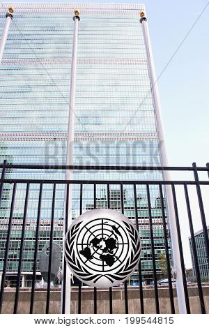 New York USA - 26 September 2016: The United Nations Headquarters Building viewed through the fence with UN Logo - located on First Avenue Manhattan.