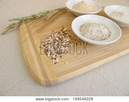 Ingredients for rye bread with rye flour, rye groats, rye sourdough and seed mixture