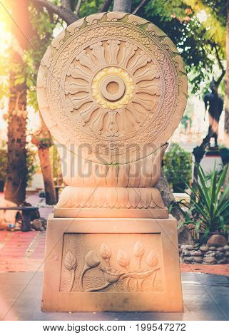 Vintage Image Style, The Wheel Of Dharma Of Temple Garden With Sunlight  In Bangkok, Thailand