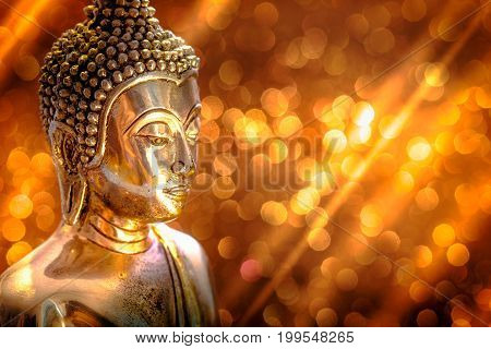 Selective Focus Of Buddha Statue With Soft Lighting Effect And Glitter Abstract Background With Boke