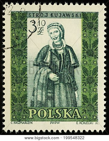 Moscow Russia - August 12 2017: A stamp printed in Poland shows woman in Polish traditional costume Kujawy region series