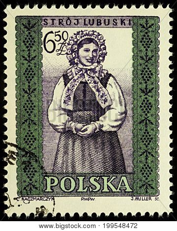 Moscow Russia - August 12 2017: A stamp printed in Poland shows woman in Polish traditional costume Lubuskie region series