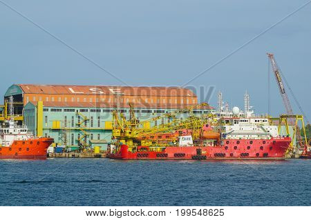 Labuan,Malaysia-July 20,2017:Platform supply vessels in Labuan,Malaysia.Its often abbreviated as PSV,is a ship specially designed to supply offshore oil & gas platforms. These ships range from 50 to 100 meters in length & accomplish a variety of tasks.