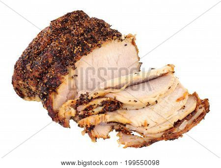 Roasted peppered pork joint isolated on a white background