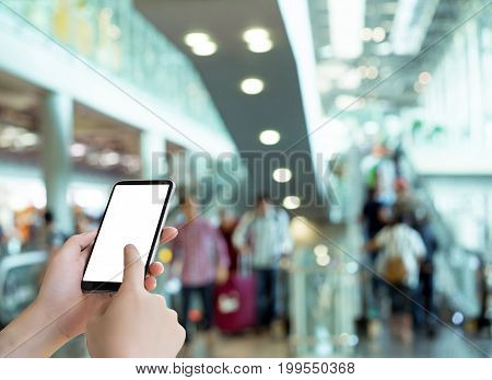 Hand holding smartphone mobile device techonology connection blank screen in airport airline for booking ticker online travel.
