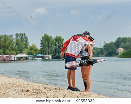 Man embracing his girlfriend before wakeboarding competition. Ukraine, Dnepr July 14, 2017. World Championship in Water Skiing.