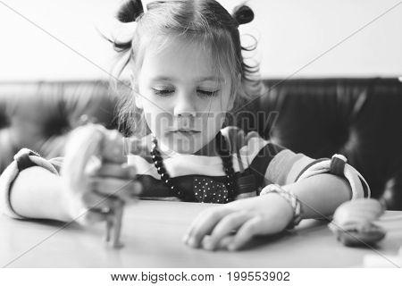 Girl Playing Dolls