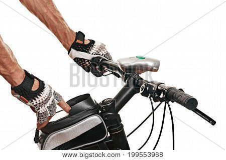 male sportsman clicks on a smartphone in a bag of modern bike. white background