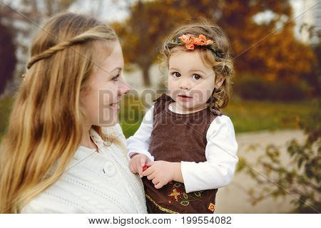 Mother And Daughter At Fall
