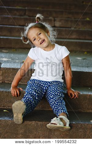 cute and fashion toddler girl in the street