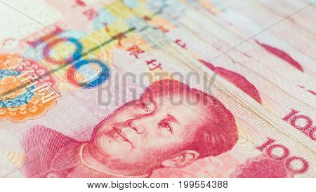 Closeup Chinese yuan banknotes, China's currency bills for money background poster