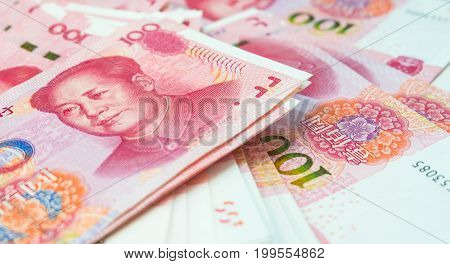 Stack of chinese yuan banknotes, China's currency bills for money background.
