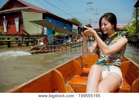 Young Traveler Woman Holding Camera