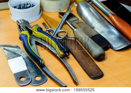 Hand tools for manufacturing and repairing shoes.