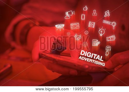 Close up woman using mobile phone with Digital advertising word and icon features Digital lifestyle concept,Duotone color filtered.