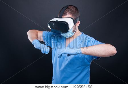 Medic Wearing Scrubs Using Virtual Reality Glasses