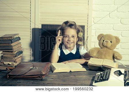 Child With Briefcase And Typewriter On Table.