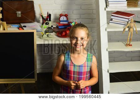 Girl With Happy Face Expression In Front Of Desk
