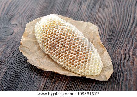 Honey bee wax honeycomb cells with sweet honey