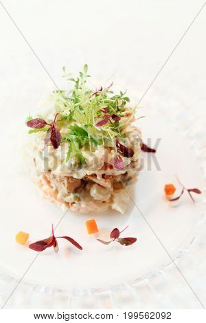 Russian salad cooked in a modern way, toned image