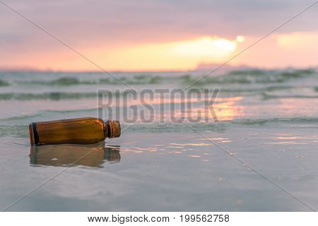 Glass Bottle On Tropical Sea Beach.