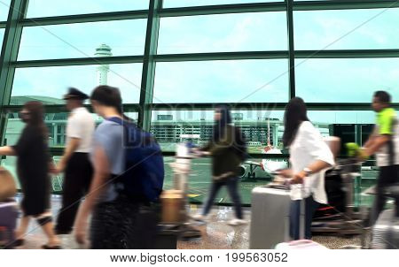 People arrival at the airport terminal with blur motion