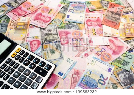 Money exchange concept World money background US Dollar Australian Dollar Chinese Yuan and Euro with calculator and copy space.