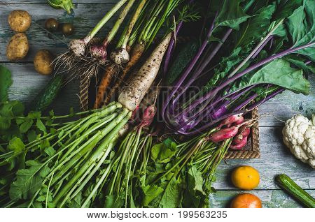 Unwashed Vegetables With Leaves In Wooden Box Over Old Wooden Background