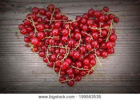 Heart shape from redcurrant. Love theme concept for Valentine's background and love theme.