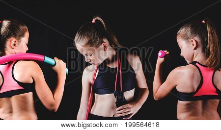 Young fitness girl on black background. Sport or healthy lifestyle concept