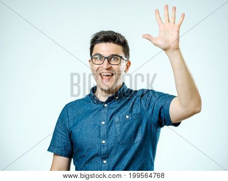 Young Man Making High Five Gesture