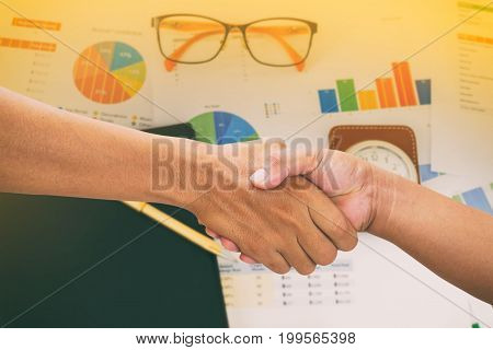 Businesswoman Handshake On Business Concept Of Office Working And Analysis Graphics And Clock On Tab