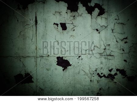 Peeling plaster on the wall with dark edges like in horror movies (as an abstract grungy background)
