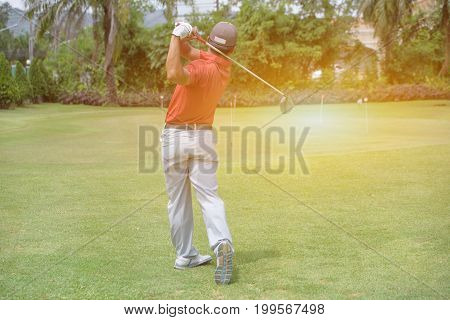 Asian golfers man hit sweeping golf course in the summer (golf background game)