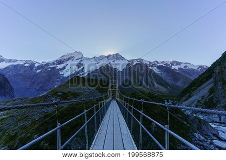 Aoraki /Mount Cook National Park New Zealand - April 21 2017 : Suspension bridge over Hooker River upstream of Mueller Glacier lake Hooker valley walking track