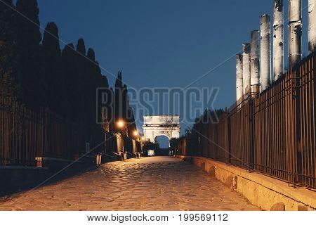 Arco di Tito (Arch of Titus) at night in Rome, Italy.