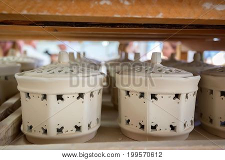 Close up image of two delft bowls with lids without painting