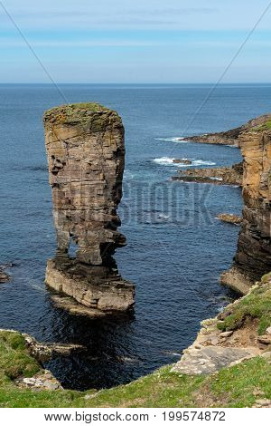 Yesnaby Sea Stackwest Orkney mainland UK. An imposing sea stack perched on a precarious looking arch