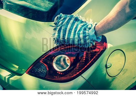 Man Washing His Car - Car Washing And Car Cleaning Concept