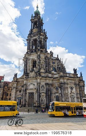 DRESDEN GERMANY - SEPTEMBER 09 2015: Cathedral of the Holy Trinity (Katholische Hofkirche) and the city tram. Dresden is the capital city of the Free State of Saxony.
