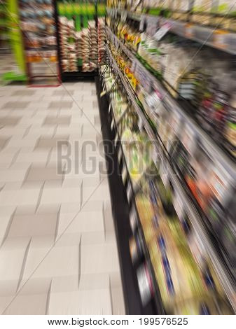 blurred images of shelves in a supermarket with dry vetetables and fruits. for healty and vegan concepts. no people. italian store