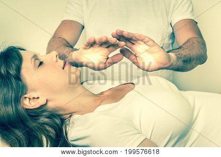 Young Woman Having Reiki Healing Treatment