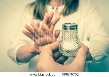 Woman refusing salt using gesture stop - health care concept - retro style