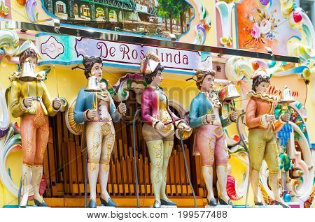 Rotterdam The Nederlands - July 17 2016: The colorful puppets of an ancient organ in the Beves Plein shopping area