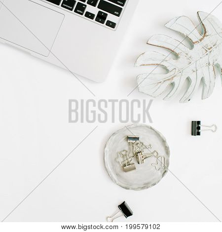 Flat lay home office desk. Female workspace with laptop and accessories. Top view feminine background.
