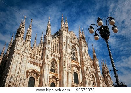 Duomo and lamp post at Cathedral Square or Piazza del Duomo in Italian, the center of Milan city in Italy.